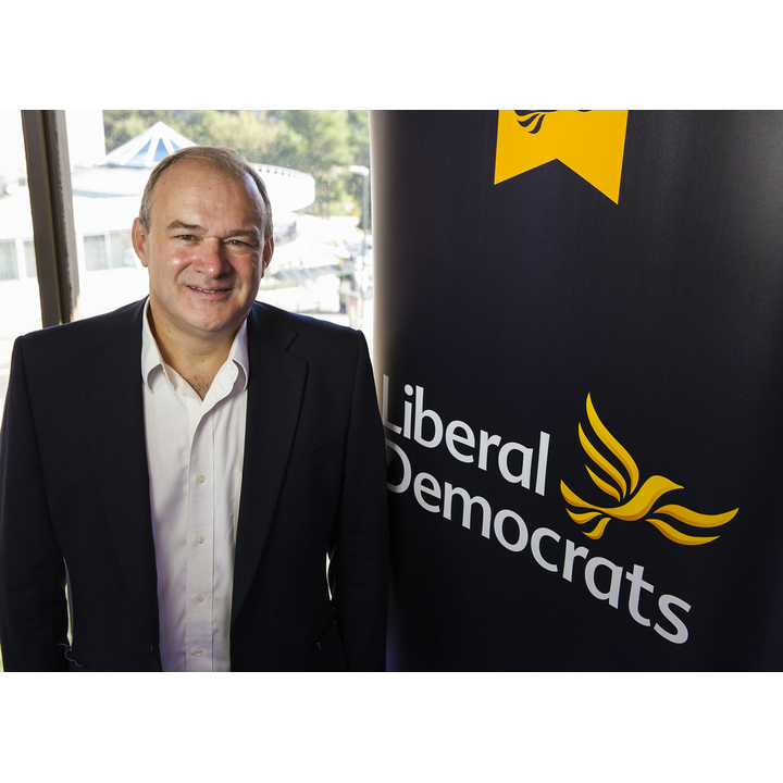 Ed Davey with Banner